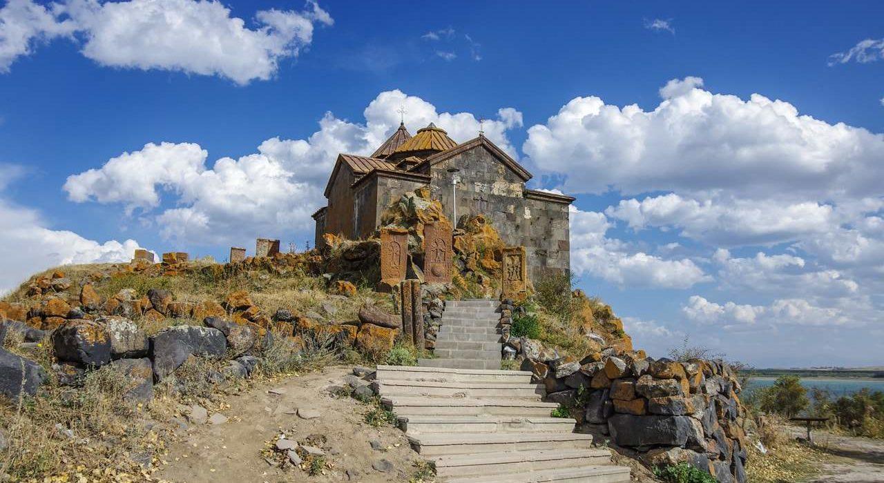 Khachkars at the monastery Hayravank. Lake Sevan shore, Armenia-min